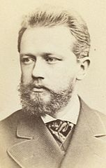 Pyotr Ilyich Tchaikovsky, head-and-shoulders portrait, facing slightly left, between 1880 and 1886. Wikimedia Commons.